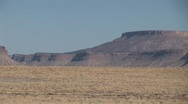 Stock Video Footage of Pan of Distant Buttes