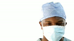 Surgeon pulls down facemask and gives good news. - stock footage