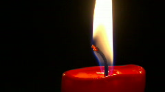 Candle in blackness Stock Footage