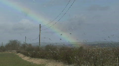 Rainbow through rain spattered window Stock Footage
