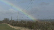 Stock Video Footage of Rainbow through rain spattered window