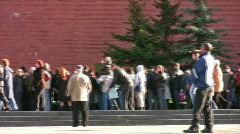 People near red wall. October 10 2008 in Moscow Russia. Stock Footage