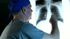 Doctor with X-Ray explaining findings Stock Footage