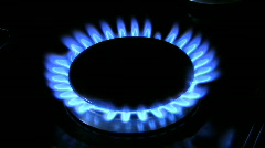 Flames on a gas ring burner of a natural gas cooker. - stock footage