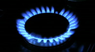 Stock Video Footage of Flames on a gas ring burner of a natural gas cooker.