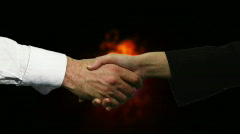 Handshake with Explosion in the background Stock Footage