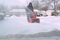 Stock Video Footage of Homeowner removing snow
