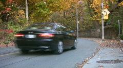 Car goes around corner. Autumn in Toronto. Stock Footage