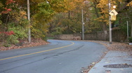 Car goes around corner. Autumn in Toronto. Stock Footage