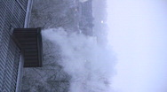 Smoke coming from chimney winter morning vertical orientation 2  Stock Footage