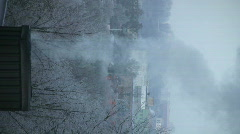 Smoke coming from chimney winter morning vertical orientation 3  Stock Footage