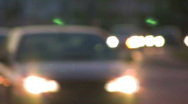 Stock Video Footage of Nightime traffic into focus