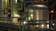 Oil refinery at night 5 - zoomout Stock Footage