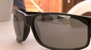Sunglasses On Table Close Up Stock Footage
