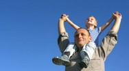 Senior with boy on shoulders Stock Footage