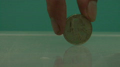 Spinning Coin - 25 Cents Stock Footage
