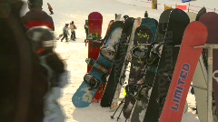 Sports and fitness, ski hill, #6 snowboards waiting Stock Footage