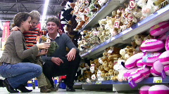 Family with boy in toy shop Stock Footage