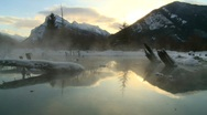 Stock Video Footage of winter scene, warm spring on frozen lake, Banff