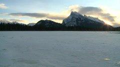 Sunrise Mt Rundle and frozen lake, Banff Stock Footage