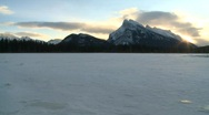 Stock Video Footage of sunrise Mt Rundle and frozen lake, Banff