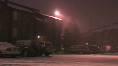 Snow on apartment parking lot Stock Footage