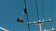 Boots on powerlines Stock Footage