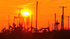 Oil donkeys at sunset - stock footage