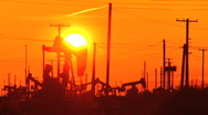 Stock Video Footage of Oil donkeys at sunset