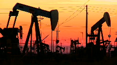 Oil donkeys at sunset Stock Footage
