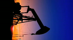 Vertical view of oil donkeys at sunset Stock Footage