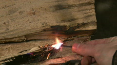Match Head Igniting in Fireplace Stock Footage