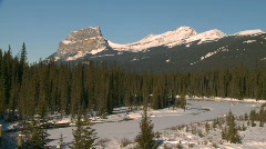 River and waterfall, river and snow covered mountains, Banff Stock Footage