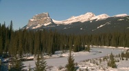 Stock Video Footage of river and waterfall, river and snow covered mountains, Banff