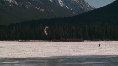 Sports and fitness, kite skiers lake Mt Rundle, #2 Stock Footage