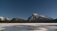 Stock Video Footage of fitness, kite skiers lake Mt Rundle, #1