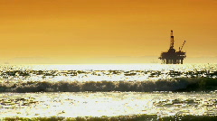 Oil platforms at sunset Stock Footage