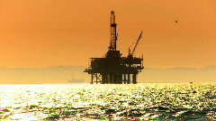 Oil platforms at sunset - stock footage