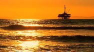 Stock Video Footage of Oil platforms at sunset