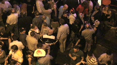 Overhead Close-up View of Street Party with People at Night Stock Footage