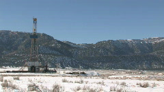 Oil drilling rig mountain close pan M HD Stock Footage