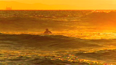 Surfers at sunset Stock Footage