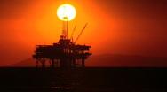 Oil platforms at sunset Stock Footage