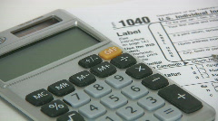 Tax Time With U.S. Tax Form 1040 And A Calculator Stock Footage