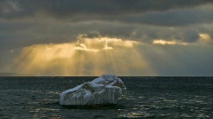 Timelapse of sunbeams over ice berg Stock Footage
