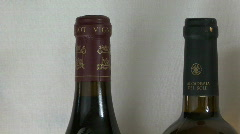 Pan over wine bottle necks - left to right Stock Footage