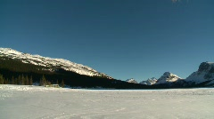 Bow lake and mountain, #13 pan, mid winter, frozen and cold Stock Footage