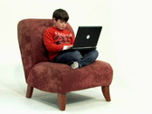 Boy 2 Uses Laptop - Wide (SD) Stock Footage