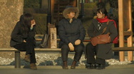 3 woman on a bench inside Ritan Park in Beijing, China Stock Footage
