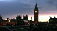 Stock Video Footage of Big Ben and Westminster Bridge at sunset with the Houses of Parliament London